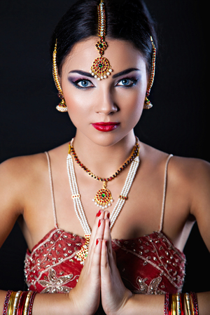 indian blue: Beautiful girl with oriental makeup and Indian Jewelry, fashion look