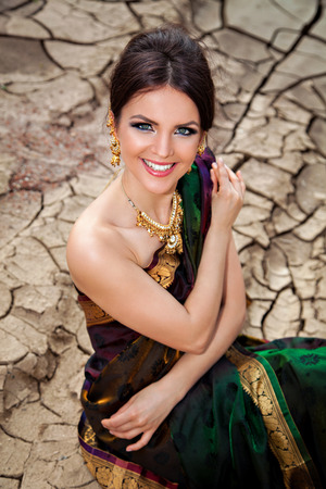 sari: Beautiful girl with oriental make-up, indian sari and indian jewelry