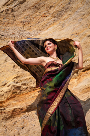 sari: Beautiful woman with oriental make-up, Indian sari and Indian jewelry