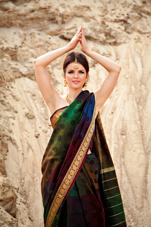sari: Beautiful girl with oriental make-up, Indian sari and Indian jewelry Stock Photo