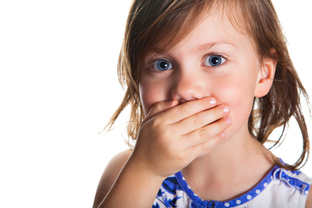 girl mouth: Portrait of a little girl who covered her mouth with hand, isolated on white background