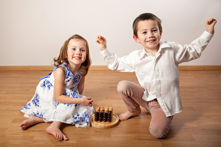 brother sister: Brother and sister sitting on the floor and playing a board game
