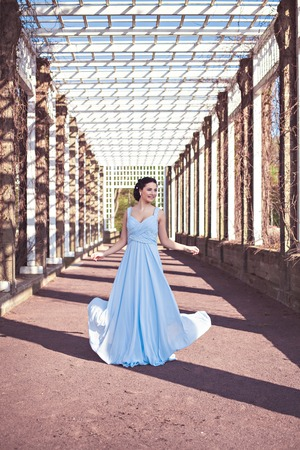 blue and green: Portrait of sensual fashion young woman in blue dress outdoor Stock Photo