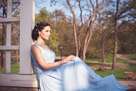 young leaves: Portrait of sensual fashion young woman in blue dress outdoor Stock Photo