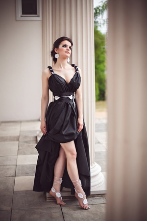 fantasy makeup: Beautiful young girl in a long black dress with fantasy make-up Stock Photo