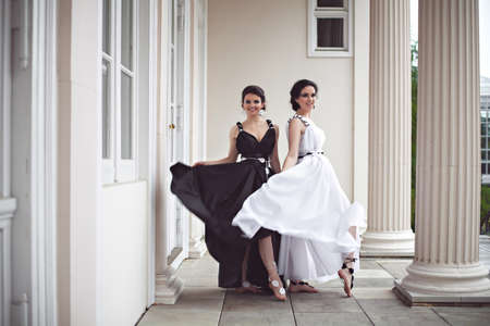 maquillaje de fantasia: Vogue style photo of two ladies in black and white long dresses with fantasy make-up