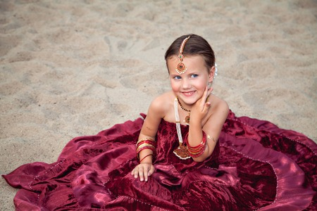 sari: Happy little caucasian girl outdoors in traditional indian sari with oriental jewellery