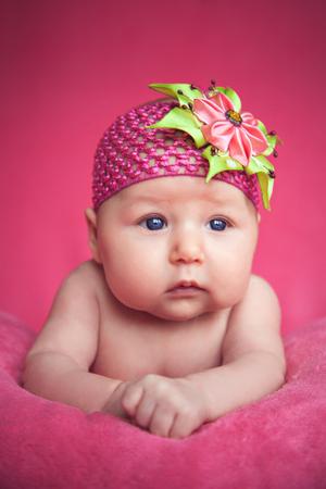 Cute newborn baby girl something grabbing her attention