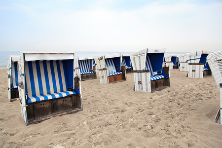 cagey: Wicker beach chairs on the beach on the baltic sea
