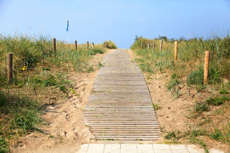 Wooden stairs over a sand dune in Warnemuende, Germany