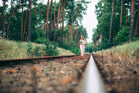 far away look: Beautiful Young Boho Styled Bride On The Railway
