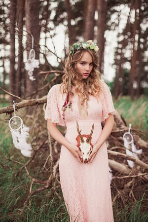 whitetail deer: Boho Bride With Whitetail Deer Skull And Antlers Stock Photo