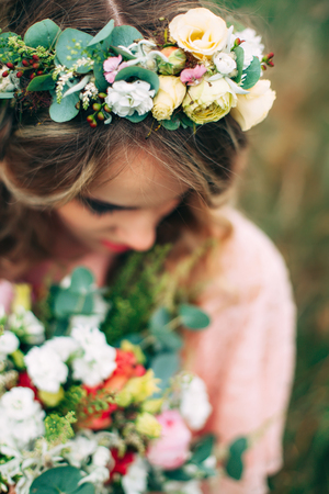 mixed marriage: Young Woman With Handsome Flower Wreath Stock Photo