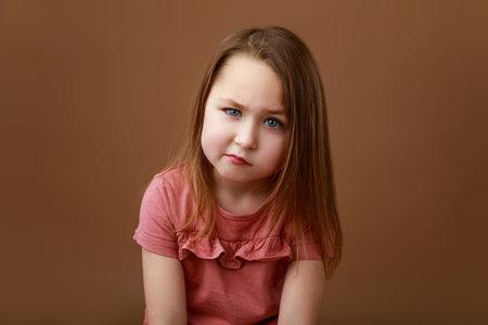 Portrait of a little preschool girl showing emotion of anger