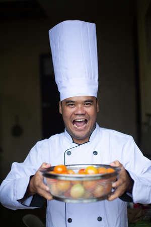 Southeast asian chef preparing healthty food