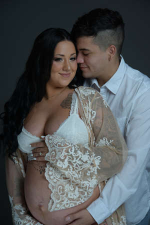 Pregnant couples Wearing white