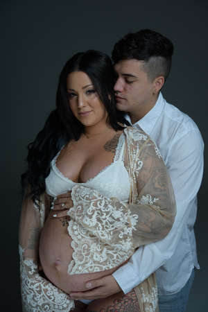 Couples wife pregnant wearing white clothes