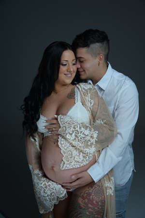 Couple wife pregnant wearing white clothes