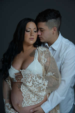 pregnant couple wearing white clothes
