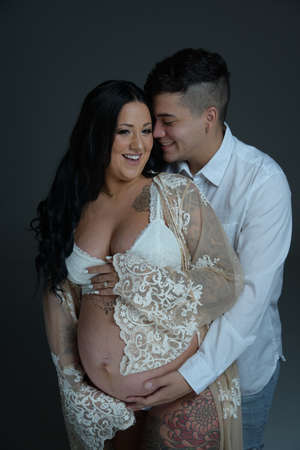 Pregnant couples Wearing white clothes