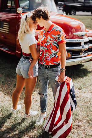 Couple in a vintage red truck