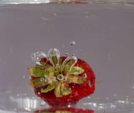 vitamine: Strawberry in water Stock Photo