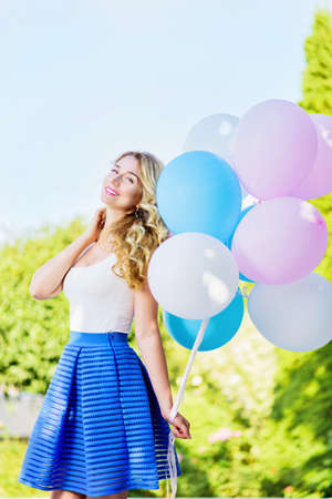 joyfull: Happy young woman with colorful balloons, Outdoors portrait