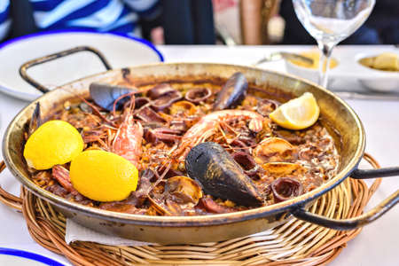 Tasty Seafood Paella in black pan -traditional spanish rice dish