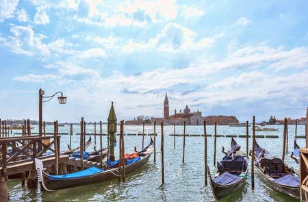Grand canal in Venice, Piazza San Marco, in the background the island San Giorgio. Scenic moody cityscape with gondolas Stock Photo