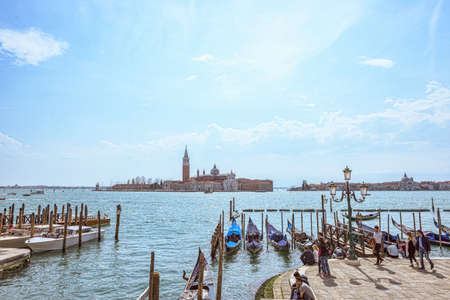 VENICE, ITALY - APRIL 02, 2017: San Giorgio island in Venice, Piazza San Marco. View from Grand Canal. Scenic cityscape with gondolas