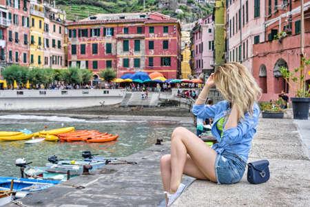 Tourist Girl in Vernazza Cinque terre Italian riviera. Sea and mountain view. Cinqueterre Liguria Stock Photo