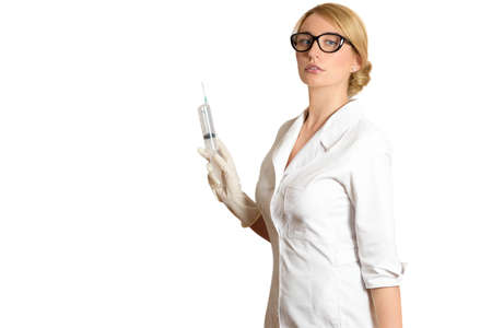 Woman nurse with a syringe isolated on white backgrounds 스톡 콘텐츠