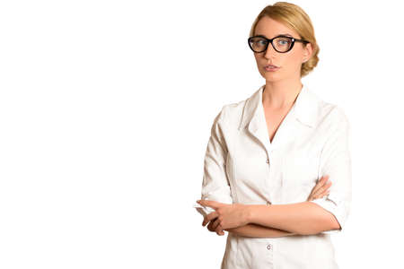 Blonde Woman doctor in uniform and with crossed hands isolated on white backgrounds