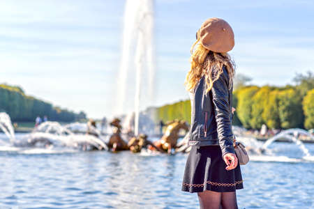 Woman in Paris, France. Young tourist girl admiring the views. French dressed style. Portrait soft bokeh backgrounds