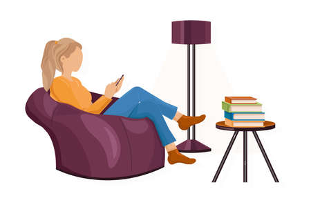 Woman with a smartphone on the sofa