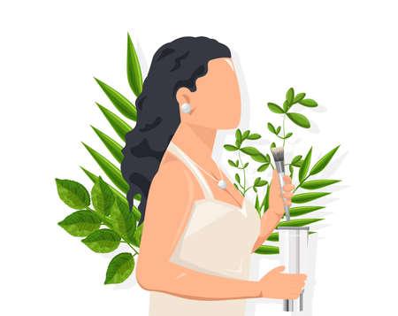 Femme aux cheveux noirs à l'aide d'une brosse cosmétique
