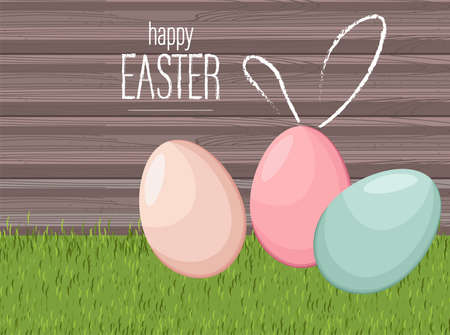 Happy easter colorful eggs on grass with wooden