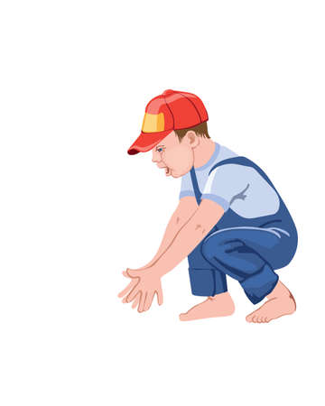 Happy little boy child clapping hands while squatting. Playing with something. Red cap and blue overall