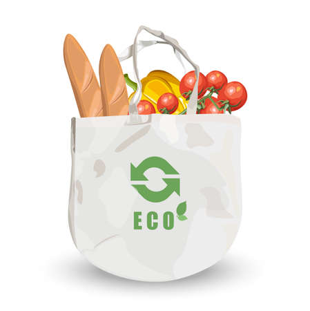 Reusable fabric eco friendly bag with groceries inside. Bread, tomatoes and pumpkin