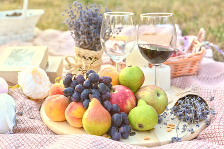 Fresh fruits and wine glass picnic outdoors. Close up tasty food lifestyle naturals