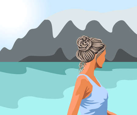 Gray haired woman in blue tank top looking at the lake and the mountains