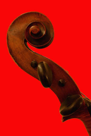 Top pf cello on red background Stock Photo