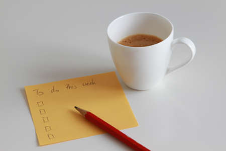 To do list with coffee and red pencil on white table Stock Photo