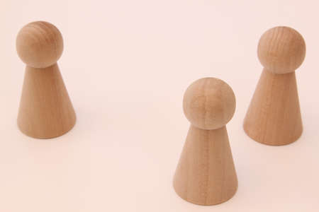 Wooden game figures on light background