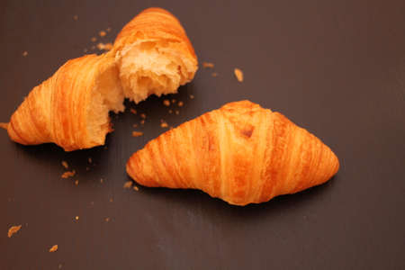 French croissant on black background