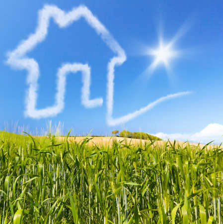 housebuilding: Concept for real estate for sale or buy  Cloud house home on a green cornfield  Concept about financing a credit for pay a housebuilding