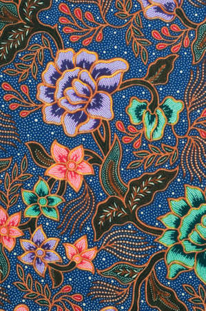 Detail of batik pattern with lavender and green flowers