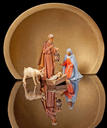 Christmas Nativity with Joseph Holding Lantern in Manger with Goat photo