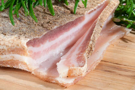 Piece of Homemade Pancetta also called Bacon or Rigatina with Seasoning Salt Stockfoto