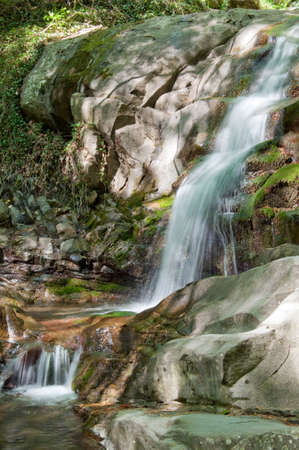 springtime waterfall in woods of Tuscany